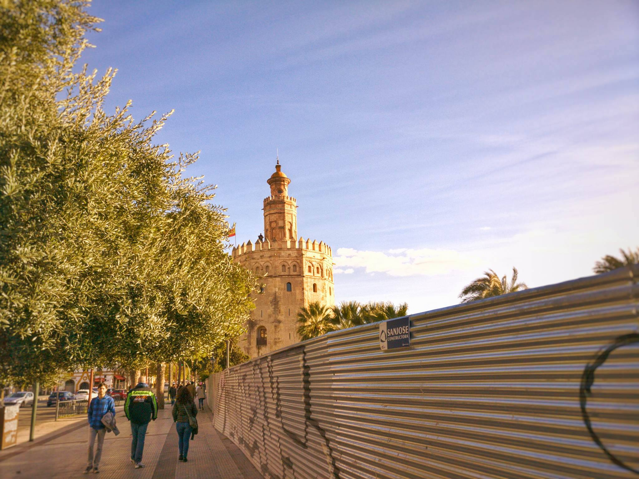 A view of la Torre del Oro in Seville, Spain in the setting sun