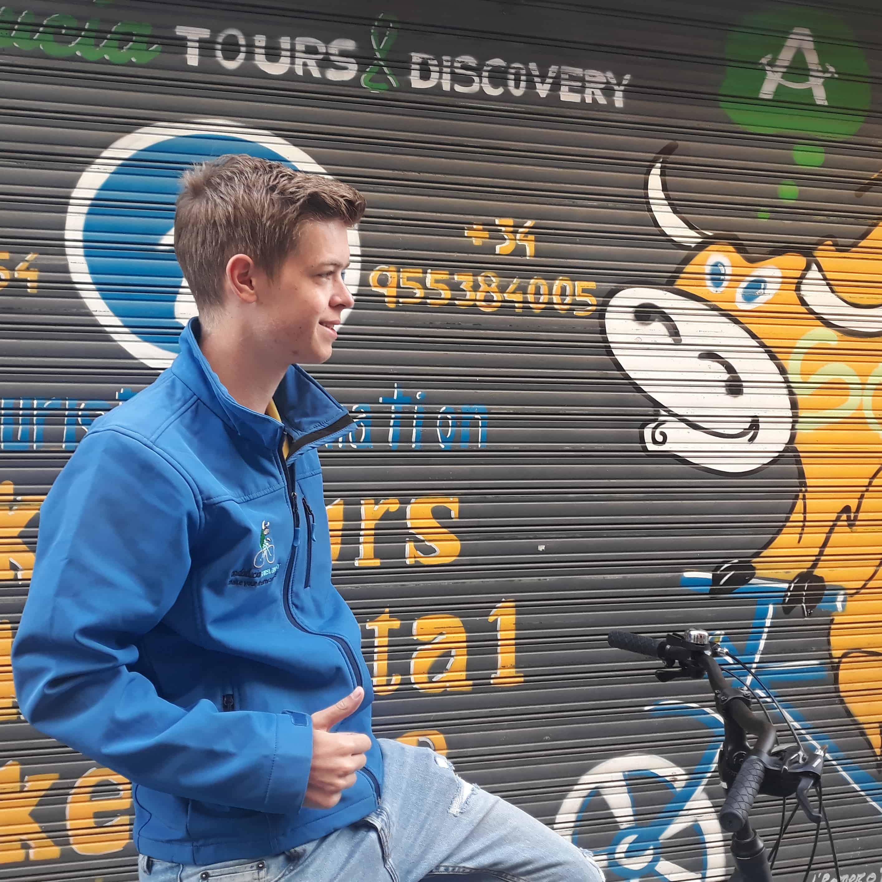 Lars on his bike in front of the store